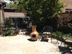 Chiminea fire pot on back patio.  Hot tub to the rear