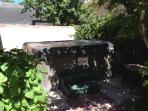 Luxury hot tub with cover lifter and watefall seats 7 in corner of private walled back yard