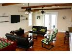 Living Space, Foosball, BluRay player, Flat Panel TV, X1 Entertainment system by Comcast, WIFI