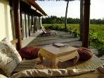 Frontdeck at ricefields with gazebo and deckchairs