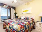 Bright and cheery beach gulf-front master bedroom with a king si