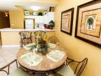 Dining are set for 4 plus two additional matching stools at the