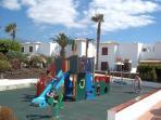 new childrens playground next to kid's pool