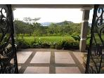 Open the doors to the living room onto the beauty of the best of Costa Rica