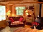 The guest cabin is furnished with a queen sized bed and a couch that coverts to a single bed.