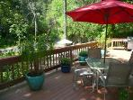 Two patios in the canyon setting; beautiful tall and mature trees surround the cottage