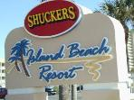 This is the sign you look for at 9800 South Ocean Drive. Shuckers is the attached beach restaurant.