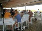 The Tiki Bar right on the beach is a great place to hang out.  Entertainment on weekends.....