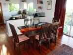 Open plan living: dining area to kitchen