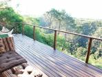 From the wooden deck, views over the valley towards the elephant sanctuary
