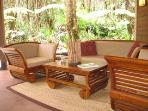 Teak, Leather and Stone compliment the Lush Greenery