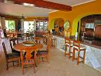 open floor plan with 2 indoor dining areas & sit up bar to kitchen