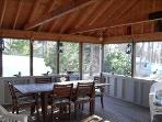 Screen porch for dining and lounging