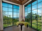 One of three master bedroom suties with panaoramic ocean views from 1200 foot above sealevel.