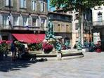 Limoux main square ringed with restaurants, bakeries and speciality shops.