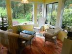 Sunroom off of bedroom with view of back garden and ponds