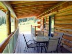 The home has a large deck on two sides of the home with plenty of outdoor furniture and a gas grill. Bird and...