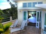 The second floor master suite opens to the roof deck.