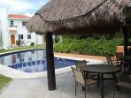 Shaded palapa by the large swimming pool. Enjoy a shaded meal by the pool