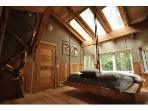 Master Bedroom & Hanging Bed with Juniper Log Ladder to access sleeping loft