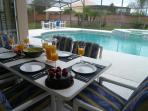 Have dinner out on the pool deck  -  seating for 12 at 2 tables.
