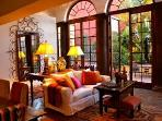 THE SUN STREAMS INTO THE GREAT ROOM OF CASA CAROLE, DECORATED WITH  BEAUTY AND COMFORT IN MIND.