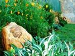 The compact landscaped garden is a favorite place for our visitors to laze around on sunny days
