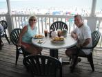 Enjoying seafood oceanfront at Conch Cafe - We rode our bikes here!