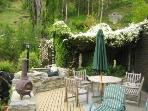 Cherry tree house patio and barbeque, a private area from other guests. Sheltered and sunny.