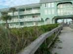2014 Building painted tan w/white trim Private Boardwalk to Beach
