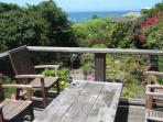 Back top deck with garden and ocean views