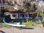 Let's go to the coast. The beach bar at Carvajal has a lovely garden