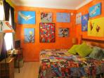 King Bedroom Downstairs Front  Rest in flight with tropical bird decor.