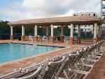 Heated pool closest to our unit with covered area and plenty of seating.