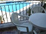 The balcony overlooks the swimming pool
