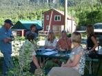 Guests enjoying wine on the patio at Ski Town Condos.