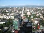View of SM Cubao and mountains