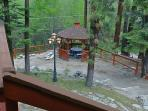Summertime view of the gazebo.  From the deck you can hear the brook babbling across the way