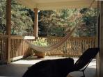upstairs porch has hammock, sofa, 2 loungers and several chairs for relaxing the day away