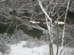 another snow picture of back yard, you can see the flat rock in river as ir is covered in snow