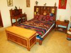 Guest bedroom with hand made hardwood furntiture througout