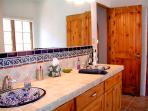 Master bath with double Talavera sinks, separate tub and shower