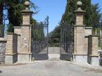 A wrought iron gate opens to your private home near Rome