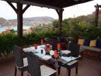 Enjoy dinner on terrace with beautiful Bay views.