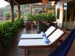 Relax in hammock or lounge chairs on spacious terrace.