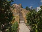 Steps that lead from bottom garden to terrace and Bougainvillea cottage.