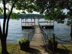 Deep Water Private Dock with an Open Boat Slip, Swim Platform and Seating.