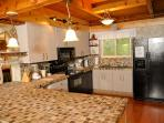 Large kitchen, stone counters and all the tools to cook a great family meal! Fabulous for holidays!