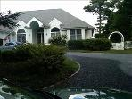 Front of home and spacious driveway.