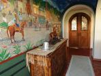 Hacienda style doors and a mural mark the entrance to the luxury Master suite.